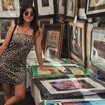 Yound woman in leopard dress at art booth