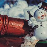 wine bottles with toy snowman