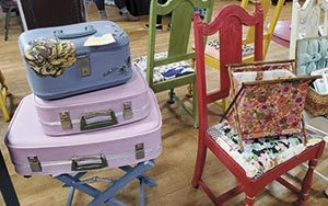 Colorful chairs and suitcases